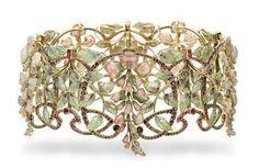 """An Art Nouveau multi-gem and enamel """"glycines"""" tour-de-cou, by Philippe Wolfers"""