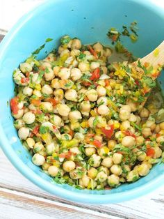 Easy and flavorful Chickpea Salad. So quick to throw together and always a crowd pleaser!  This is a great healthy salad to bring to a potluck.  Vegan and gluten-free salad recipe.