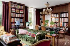 Settling in to read on the green chesterfield. Home of Interior Designer Sig Bergamin. Photographer: Roger Davies for Architectural Digest. Architectural Digest, Bookshelf Design, Bookshelves, Living Spaces, Living Room, Home Libraries, Deco Design, Lofts, Colorful Interiors