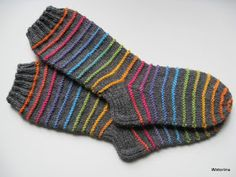 Inspired by the dainty lilac flower and starting with a scalloped edge, these socks are knit from the cuff down and embellished with flowers created b Fair Isle Knitting, Knitting Socks, Mitten Gloves, Mittens, Knitting Projects, Knitting Patterns, Winter Socks, Yarn Bombing, Wool Socks
