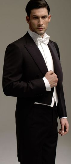 Wear a modern tuxedo with tails, like this one that can be procured from any rental company. Add a Regency cravat, waistcoat and shirt, and the look is carried well. Let it be in a natural fabric and fitted to you like a glove. White Tie Wedding, Wedding Tux, Cruise Wedding, Modern Tuxedo, Classic Tuxedo, Groom Attire, Groom And Groomsmen, Tuxedo With Tails, Black Tie Affair