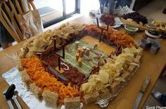 What is on the menu for Super Bowl? Maybe this. Guacamole field; cheese dip and salsa end zones; Slim Jim goal posts; sour cream yard markers; Ruffles, tortilla chips, Cheetos and Doritos for fans; vienna sausages with cheese helmets for players; rice crispy treat stadium; hot dogs with bacon separating the fans from the field.