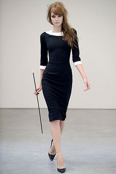 Boat neckline white trim sleeves and neckline pointy black heels black fitted knee length dress