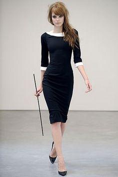 Boat neckline white trim sleeves and neckline pointy black heels black fitted knee length dress