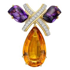 "Tiffany & Co. Paloma Picasso Citrine Amethyst Diamond Brooch. Gem-set brooch, designed as a diamond-set 'X' motif flanked by polished amethysts, suspending a larger pear-shaped citrine drop, mounted in 18k yellow gold and platinum, circa 1985, signed Paloma Picasso/Tiffany & Co. 1.90"" length and 1.75"" width at widest point. c1985"