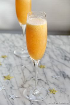 Peach Bellinis - 1 cup frozen peaches, 1/4 cup peach schnapps, 1 1/2 tblsp sugar, 1 cup ice cubes, 1 cup champagne or prosecco
