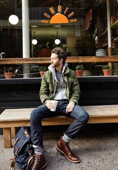 An olive military jacket and navy blue jeans feel perfectly suited for weekend activities of all kinds. A pair of dark brown leather casual boots will bring a strong and masculine feel to any ensemble. Shop this look on Lookastic: https://lookastic.com/men/looks/military-jacket-hoodie-crew-neck-t-shirt/23448 — Navy and White Horizontal Striped Crew-neck T-shirt — Grey Hoodie — Olive Military Jacket — Navy Jeans — Navy Canvas Messenger Bag — Grey Socks — Dark Brown Leather Casual Bo...