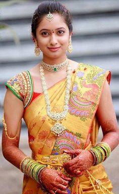 South Indian bride. Gold Indian bridal jewelry.Temple jewelry. Jhumkis.Gold silk kanchipuram sari.Braid with fresh flowers. Tamil bride. Telugu bride. Kannada bride. Hindu bride. Malayalee bride.Kerala bride.South Indian wedding.
