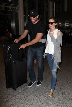 Emily Blunt and John Krasinski arrive at Toronto Pearson International Airport during the 2015 Toronto Film Festival