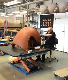 Hans Mannerhagen working on an Egg chair. He hand stitches every one!