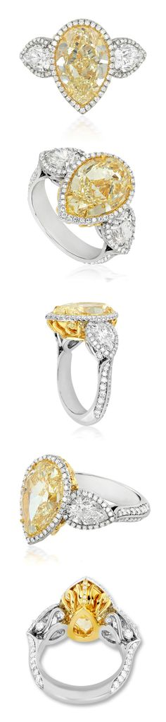 A stunning blend of artistry and craftsmanship, this exquisitely designed platinum/18K gold ring features a 5.61 carat SI1 pear shaped…