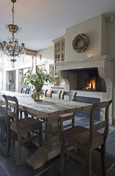 fireplace in dining and chandelier