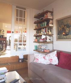 Vintage Pottery adds decoration and storage to a book shelf. ~ Mary Walds Place - Right Now