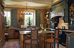 Kitchen with exposed brick wall, rust rug & stools, dark blue-grey cabinets & shutters: Jennings & Gates: Notes from a Virginia Country House