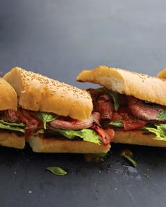 Grilled-Steak Sandwiches - Fresh basil and tomatoes add a summery accent to grilled steak sandwiches. Made on two loaves of Italian bread, this recipe serves 12 people.