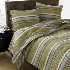 Nothing transforms a bedroom into a relaxing retreat quite like a quilt. This queen-size spread brings in a splash of calming color with gray-blue and green horizontal stripes. About $82 for a three-piece quilt set from Overstock.