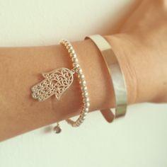 A personal favorite from my Etsy shop https://www.etsy.com/il-en/listing/455197522/100-sterling-silver-hamsa-bracelet