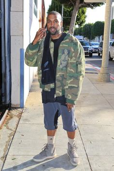 Kanye West wearing Raf Simons Manics Camouflage Jacket, Yeezy 750 Boost, Personalized Boutique Custom Made Nori 14K Gold Raised Letter Name Bar Necklace, Adidas Climalite X II Mid-Crew Socks