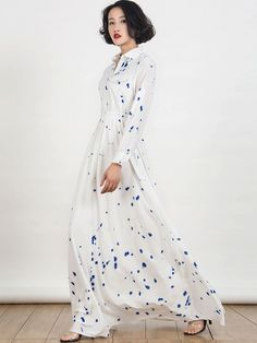 100%Polyester;This white splash print shirt collar maxi dress crafted in 100%Polyester,non-stretchable material,please hand wash cold,featuring high waist design,sleeve tab,half sleeve,in ankle length cut,in ink mark,causl style maxi dress.