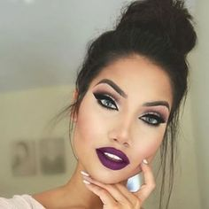Absolutely love this deep purple lipstick with a top bun and a light colored outfit!!