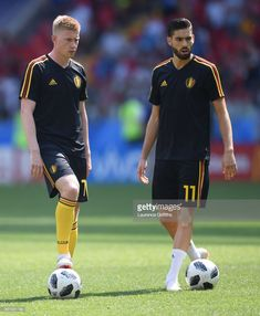 Kevin De Bruyne of Belgium and Yannick Carrasco of Belgium look on during the warm up prior to the 2018 FIFA World Cup Russia group G match between Belgium and Tunisia at Spartak Stadium on June 23, 2018 in Moscow, Russia.