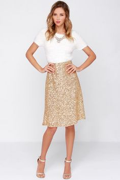 Slip on the Stage Name Gold Sequin Midi Skirt and watch as it transforms you into a shining star! Lovely gold sequins cover a layer of stretchy mesh from the high waist all the way down to the flaring midi-length hem. Hidden side zipper. Fully lined in beige satin. 65% Cotton, 35% Polyester. Hand Wash Cold or Dry Clean. Imported.