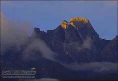 Daybreak is a spectacular moment as the first light of the day warms the summit of Low's Peak, and ever so slowly illuminates the surrounding protected area of the Crocker Range Mountains. Mount Kinabalu, Sea Level, Borneo, One Light, Natural World, Mount Everest, Exotic, Tropical, Range