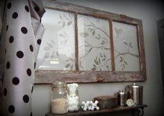 A design stencilled onto an old window makes one very pretty wall feature. Isn t this nice!?!
