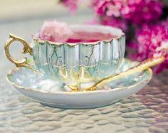 * pretty pastel aqua tea cup with gold accents photo