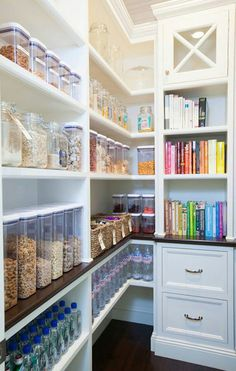 Organized pantry. Love the cook book shelving.
