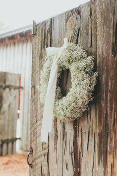 Baby's breath wreathes with white ribbon