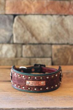 This handcrafted collar features teal and burgundy rose leathers and copper accent pieces and hardware. Great for hounds and large breeds. Made in the USA.