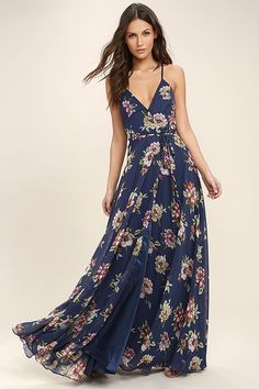 Lulus Exclusive! The Always There For Me Navy Blue Floral Print Wrap Maxi Dress is almost too good to be true! Purple, green, and beige floral print woven poly falls from crisscrossing adjustable spaghetti straps into a princess seamed, wrapping bodice (with modesty snap), and tying waist. Wrapped detail carries into a front slit maxi skirt.