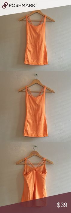 Lululemon Orange Work Out Tank SZ 4 ❌NO TRADES❌  - lululemon athletica Orange Tank Top SZ 4  - Pretty Orange Work Out Tank Top with cross back strap detail  - Size tag removed. SZ 4 sticker remains in bodice.   - Built in bra/ NO PADDING INCLUDED  - Great used condition.  Minor marks in front (see photos) lululemon athletica Tops Tank Tops