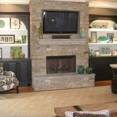 Image result for living room cabinets with stone fireplace