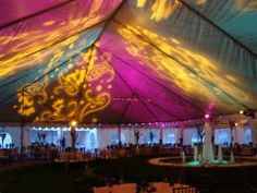 Tent lighting with monogram gobos and flood washes of pink and green & Bistro lights and a river birch tree uplit with PAR-16 lighting ...