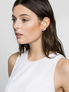 Slim crystal arcs hug the ear lobes, while organic howlite lends some statueseque polish to the finished look of these ear jackets.