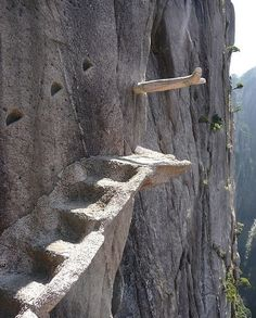 Staircase At Mountain Huangshan In China. Not sure but it looks like the steps just stop?