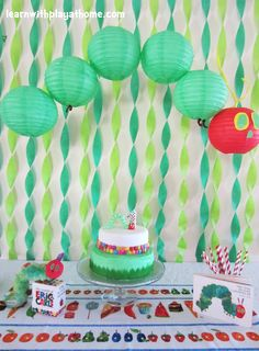 Very Hungry Caterpillar Party - streamer background is a terrific, inexpensive way to transform walls. This can be used on an exterior wall as well!
