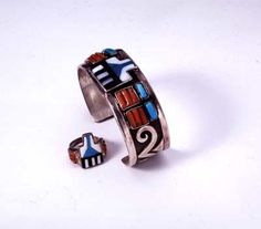 """Snow Cloud Bracelet and Ring by Paul Saufkie (Hopi); silver, turquoise, coral, shell, and jet, mid-1940s, Gregory & Angie Schaaf Collection, ill. in """"American Indian Jewelry I"""" and """"American Indian Jewelry III."""" See www.indianartbooks.com"""
