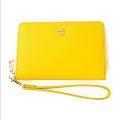 Yellow Tory Burch wallet phone case wristlet PRICE REDUCED! Brand new! Comes with gift box! 100% authentic, purchased from Tory Burch. Can provide receipt upon request. 130 Tory Burch Bags Wallets