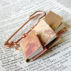 Tiny Book Triplet Pin. This adorable and unique mini book pin is the new favorite of Ambjewelry fans. Makes a great gift for librarians, writers, book lovers, teachers, and more!