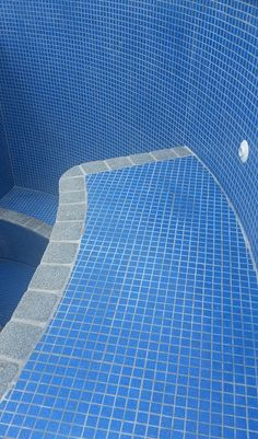 Ocean Blue tiles. Mid grey granite edge. Fully tiled bench seat.