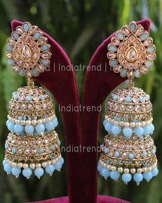 Gold Tone Earrings Studded With Simulated Polki, Multicolor Stone & Faux pearl . Measures approx : 70 x OR 2 x 1 with post back findings for pierced ears Base : High grade alloy metal Indian Bridal Jewelry Sets, Indian Jewelry Earrings, Jhumki Earrings, Jewelry Design Earrings, Ear Jewelry, Designer Earrings, Antique Jewellery Designs, Fancy Jewellery, Stylish Jewelry