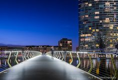 A Modern Man in a Modern World; Future Systems' floating bridge in front of Marriott Hotel by HOK & Squire + Partners - West India Quay, Docklands, London