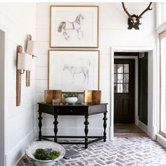 Trotting through a rustic design of #antlers and hooves. Nothing but the essentials here. #entrywaydecor #interiordesign #shiplap #herringbone #brickfloor #interiors