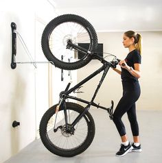 a folding, adjustable solution to fat tire bike storage and garage organization