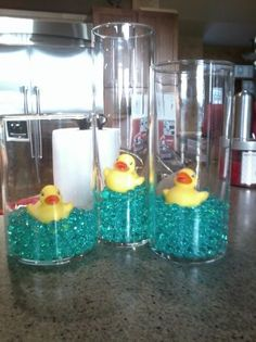 My kind of baby shower centerpieces Fill with blue glass water and lures?