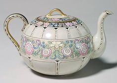 Willetts Belleek Teapot with a Colorful Satsuma likeDecoration of Victorian Flowers, accented with Fired on Gold. Marked with the Belleek Willetts Insignia and signed by the decorator, Alice Friller.