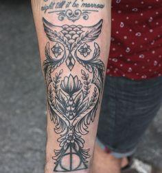 Cool owl tattoo.